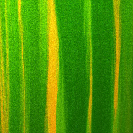 green and yellow oil on paper as easter background. Stock Photo