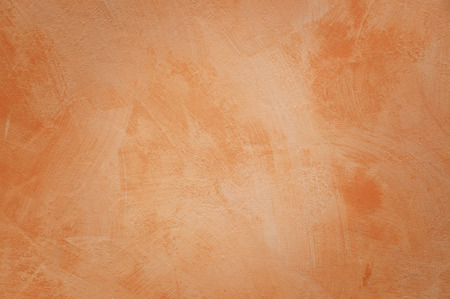 Orange wall with brush strokes as background