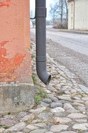 Closeup of rain pipe on old run down wall,