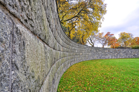 Curved stone wall in fall