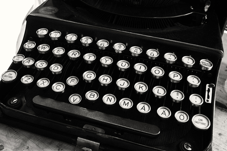 Closeup of old dusty typewriter in black and white