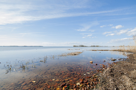 Rocky beach in Sweden with low water level, sunny day. Stock Photo