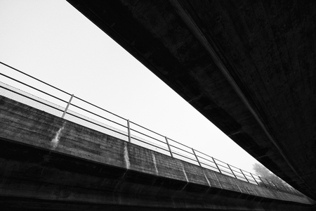 Bridge from below in black and white