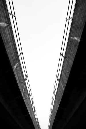 Low angle view of split bridge in black and white Stock Photo