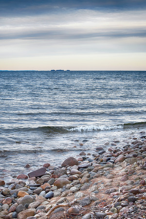 Rocky beach with blue water and waves