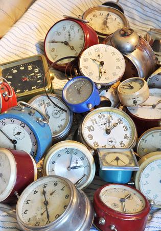 A pile of old retro alarm clock