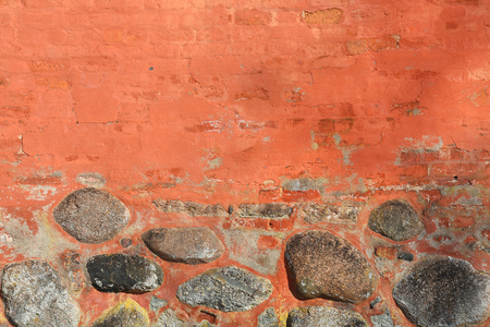 Ancient brick wall with big stones as background