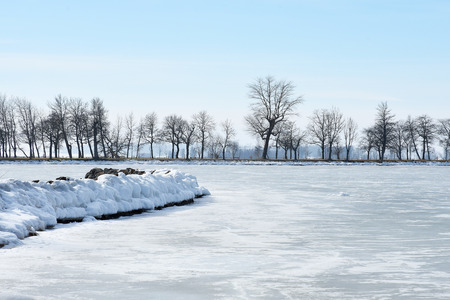 Frozen lake with stone pier in Vadstena, Sweden Stock Photo