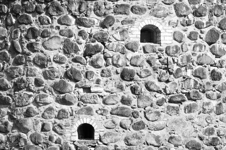Black and white image of old stone wall of a castle.