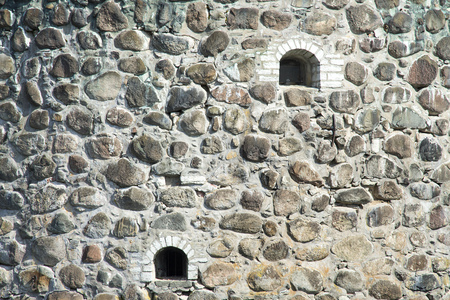 Closeup of old castle wall with windows