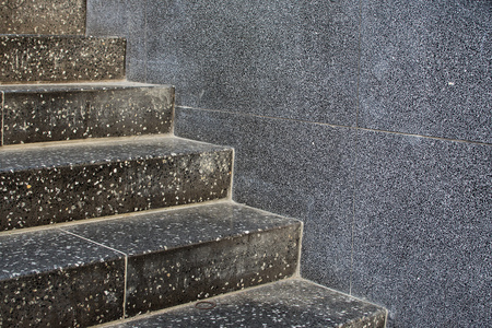 Closeup of stone stairs inside a subway staion.