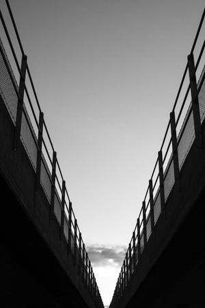 Low angle view of bridge with rail. Dark minimalism.