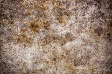 Closeup of old rough stone wall with strokes and patterns in earth colors. Stock Photo