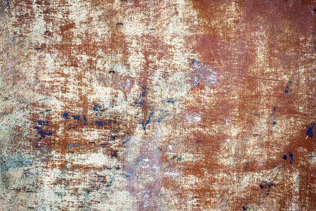 Closeup of peeling paint on old weathered wooden board.