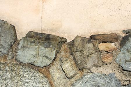 Closeup of ancient wall with big rocks. Stock Photo