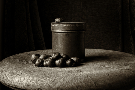 Old fashioned still life in sepia of chestnuts