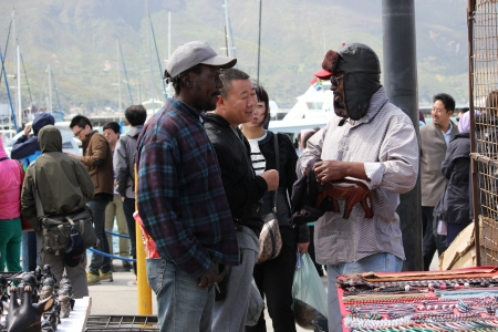 Tourists at South Africa harbor, Hout Bay