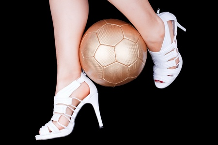female soccer: woman playing soccer with white high heels Stock Photo
