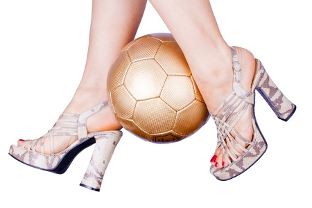 woman playing soccer with high heels in snake design photo