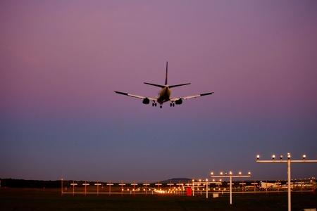 aircraft landing during sundown Reklamní fotografie