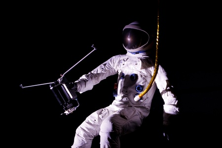 astronaut flying in outer space photo