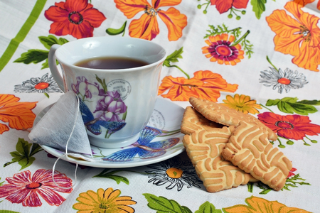 Marvelous Cup With Tea And Biscuits On Colorful Tablecloths. Photo