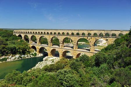 ancient Roman aqueduct In FRANCE with river beneath it