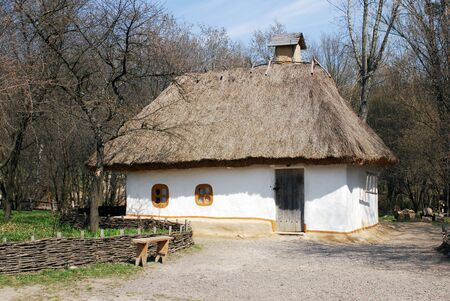 Peasant house in Ukraine village with haulm in the roof