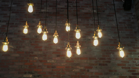 Hanging Edison Lightbulbs with Brick Wall Background