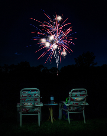 Fireworks on Black Backdrop with Chairs in Foreground