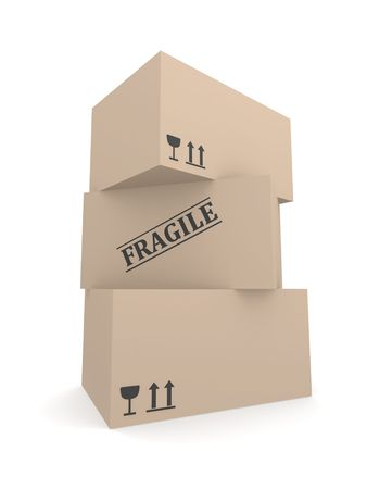 Three cardboard boxes with Fragile labels and warning symbols rendered in 3D Stock Photo