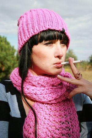 A woman smoking a cigarette Stock Photo - 3792382