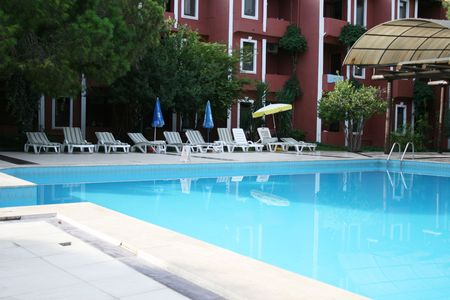 a bathing place: Large rustic hotel and swimming pool set in beautiful gardens