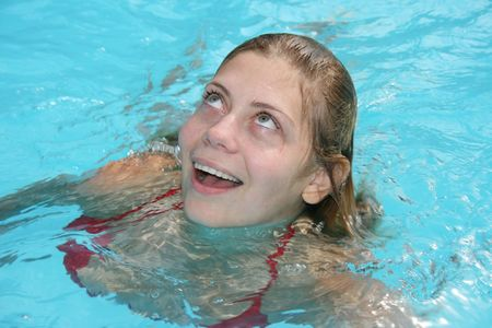 Young woman swimming in the pool