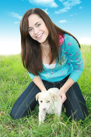 romp: girl and puppy Stock Photo