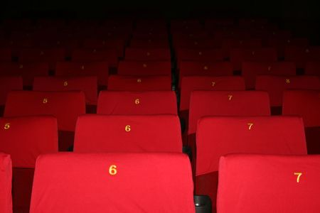 lonliness:  empty theatre auditorium cinema or conference hall.