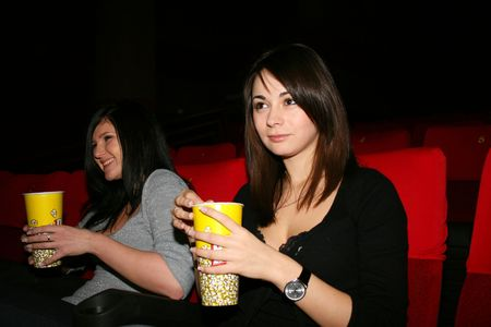 Smile girl is in cinema, look a film