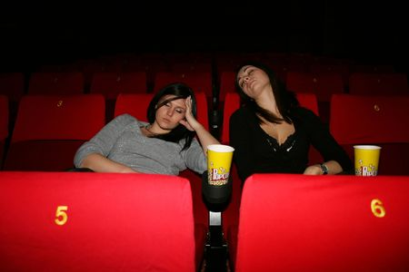 girls are in the cinema,  sleep to view of film