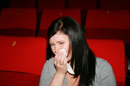 girls are in the cinema, look  film and  cry