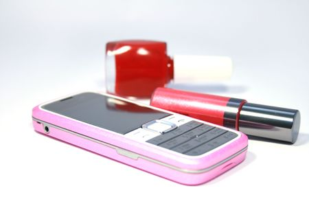 Womanish  mobile phone and  lipstick and  nail polish