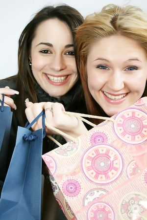 gift spending: Two beautiful smiling young woman with shopping, gift bag