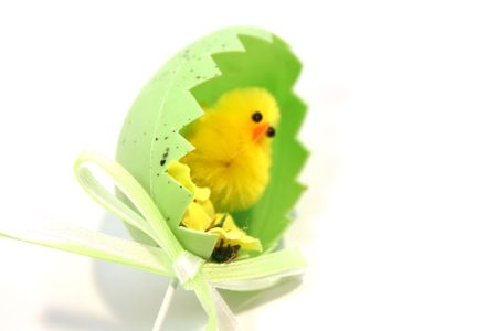 yellow toy easter chick hatching out of an egg shell Stock Photo - 4482949