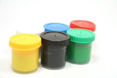many paint jars with gouache on white background photo