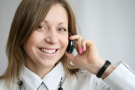 attractive young woman calling by phone photo