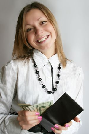 Young business woman, showing money photo