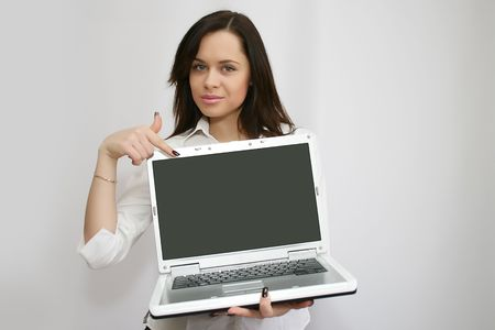 pretty businesswoman holding laptop photo