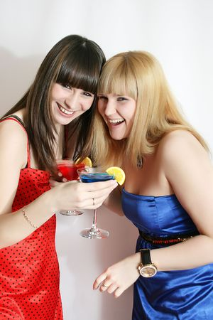 Two pretty friends celebrating, isolated Stock Photo - 4948806