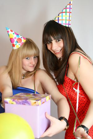 young pretty woman in birthday cap with present box photo