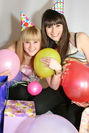 two young pretty woman in birthday cap