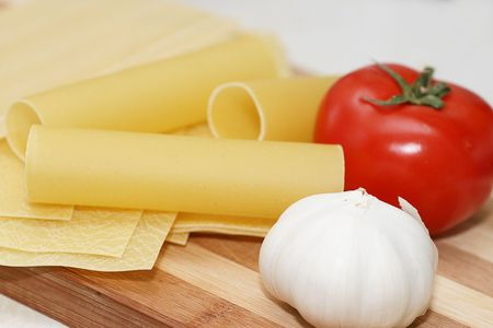 Lasagne and cannelloni sheets ready for cooking, With a tomato and garlic Stock Photo